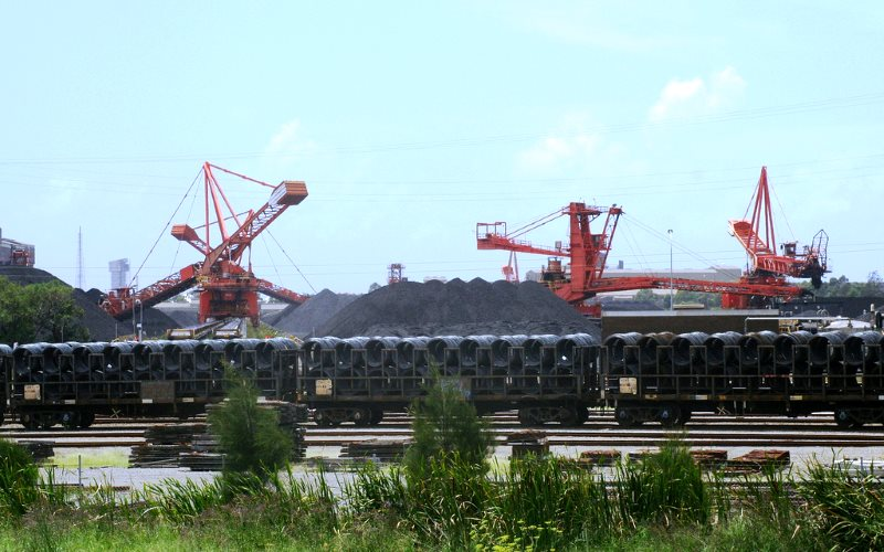 The city of Newcastle, Australia, home to the world's biggest coal port, is among those to join the divestment movement. Port Waratah Coal Loader and freight train carrying steel. Photo: OZinOH via Flickr (CC BY-NC).