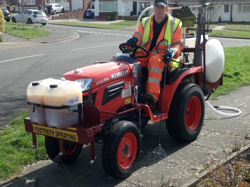 Herbicide being sprayed to keep a footpath in a residential area free of weeds. Photo: Nick Mole / PAN-UK.