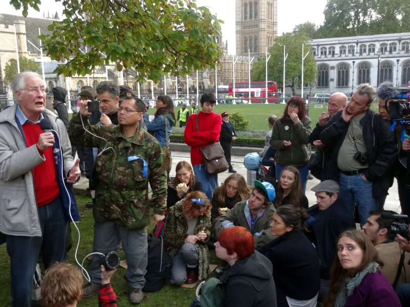 Michael Meacher MP addresses the group 'The State We Need' at the Occupy Democracy protest in Parliament Square, 25th October 2014. Photo: Sheila via Flickr (CC BY-NC).