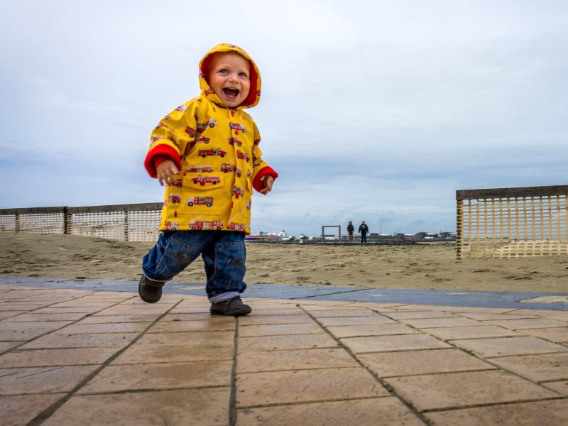 Does this rain-loving toddler need toxic PFC finishes to make his coat proof to Arctic storms? On balance, probably not. Photo: John Bastoen via Flickr (CC BY).