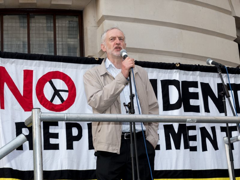 Jeremy Corbyn addresses the crowd at the 'Vote Out Trident' CND protest outside the Ministry of Defence,  London, 13 April 2015. Photo: RonF / The Weekly Bull via Flickr (CC BY-NC-ND).