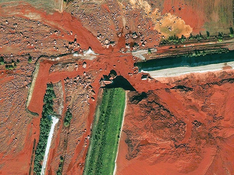 Farmland is inundated with toxic red mud following the 2010 Ajka alumina plant accident, in Hungary, which injured hundreds and killed ten. Photo: public domain.