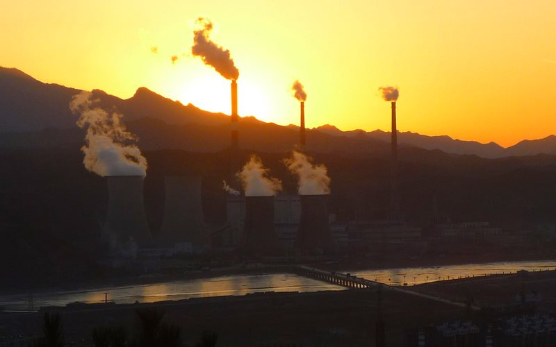 Thanks to the growth of renewables, China's coal burn is falling. And it could be part of a long term trend of declining global emissions. Photo: Chengde, Hebei, China, by Gustavo M via Flickr (CC BY).