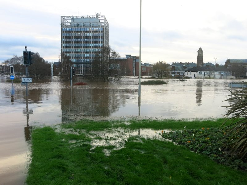 Flooding in Carlisle. With warming climate, there's much worse to come. Photo: John Campbell via Flickr (Public Domain).