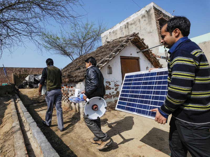 We need renewable energy deployment now! Simpa Networks technicians in Sonsa Village, Mathura Uttar Pradesh. Photo: Asian Development Bank via Flickr (CC BY).