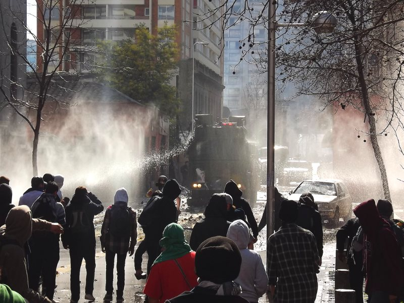 Water cannon deployed against a March for Education in Chile, 9th August 2011. Next time, it could be drones armed with incapacitating chemical agents. Photo: Mauricio Ulloa via Flickr (CC BY-NC-SA).