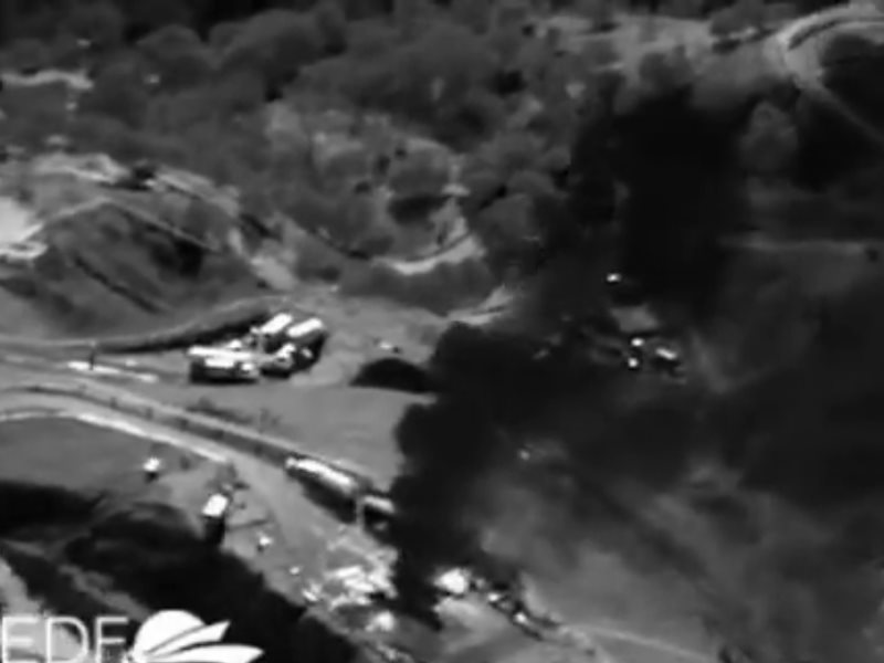 The Aliso Canyon methane cloud seen in infra-red as a dark, menacing plume erupting from the breached gas well. Photo: from video (see embed) by Pete Dronkers / Environmental Defense Fund.