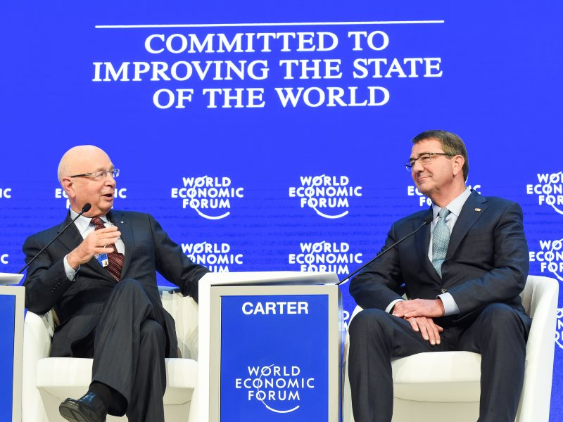 'Committed to Improving the State of the World' - of course they are! Secretary of Defense Ash Carter speaks with Mr. Klaus Schwab at WEF16 at Davos, Switzerland, 22nd January. Photo: US Army Sgt. 1st Class Clydell Kinchen / DoD via Flickr (CC BY).
