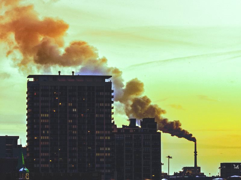 The smokestack of the now-defunct Fisk Generating Station spewing soot, sulfur and mercury over Chicago's Pilsen neighborhood, and elsewhere, January 2012. Photo: Seth Anderson via Flickr (CC BY-NC-SA).