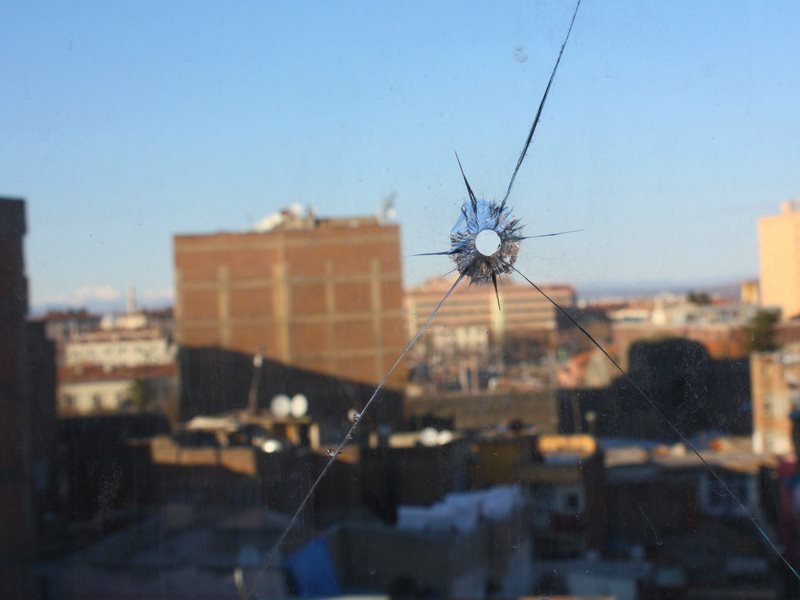 View from Diyarbakir hotel window, with bullet hole. Photo: William John Gauthier via Flickr (CC BY-SA).