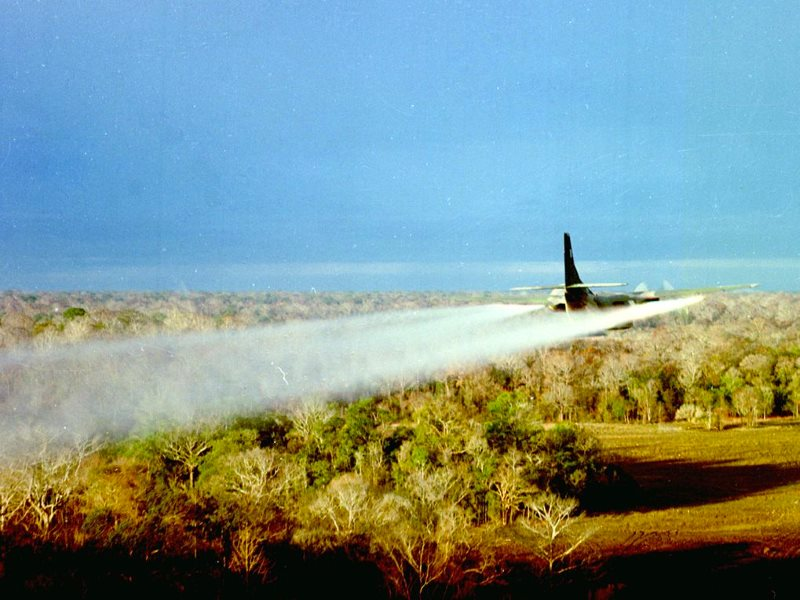 A US Air Force Fairchild UC-123B Provider C-123 Ranch Hand aircraft sprays defoliant over the target area of Operation Pink Rose in January 1967. Photo: US Air Force via Wikimedia (Public Domain).