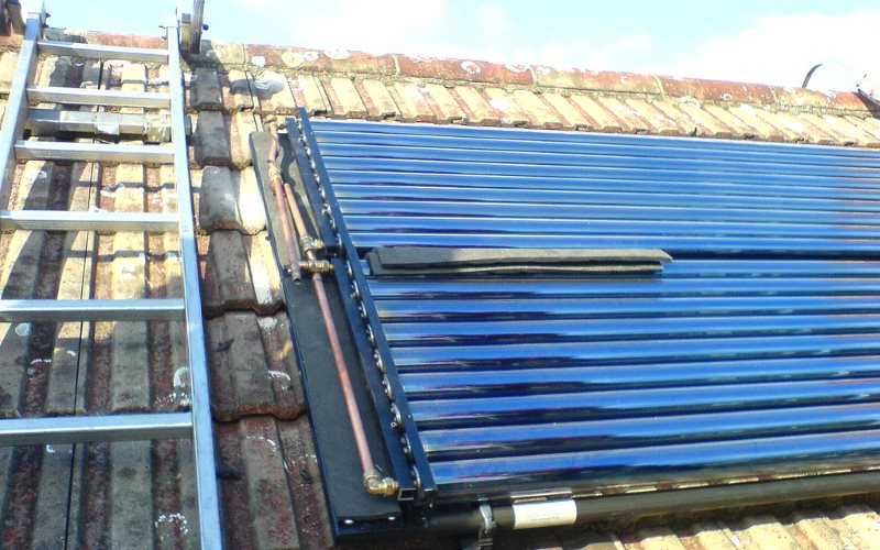 Solar heating evacuated tubes being installed on a roof in Thorton Heath, England. Photo: szczel via Flickr (CC BY-NC-SA).