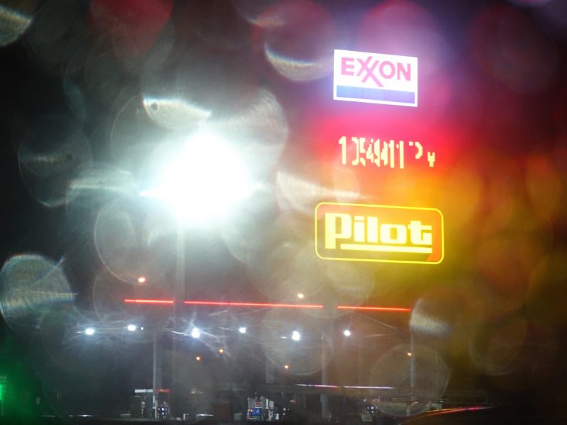 Smoke, mirrors and raindrops: Exxon station at Columbus, Montana. Photo: J.C. Burns via Flickr (CC BY-NC-ND).