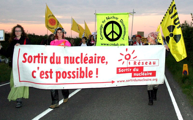 'Getting out of nuclear - we can do it!', reads the banner at this 2011 protest against Hinkley C. French Energy Minister Segolene Royal might just share the opinion. Photo: Campaign for Nuclear Disarmament via Flickr (CC BY).