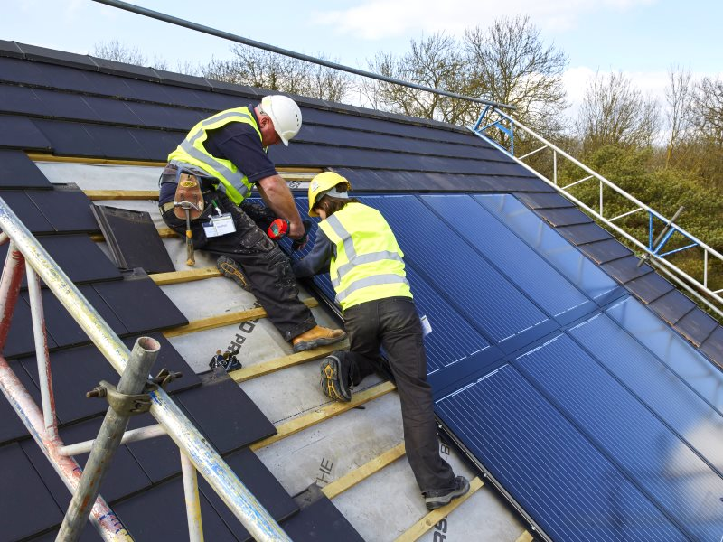 Installing a Solarcentury 'Sunstation', which embeds into the roof rather than sitting above it. Photo: Solarcentury.