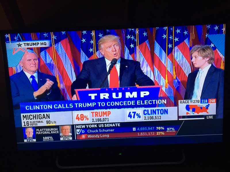 Trump delivers his victory speech, calling for all Americans to unite as one people. Photo of NBC live coverage by T D Cabot.