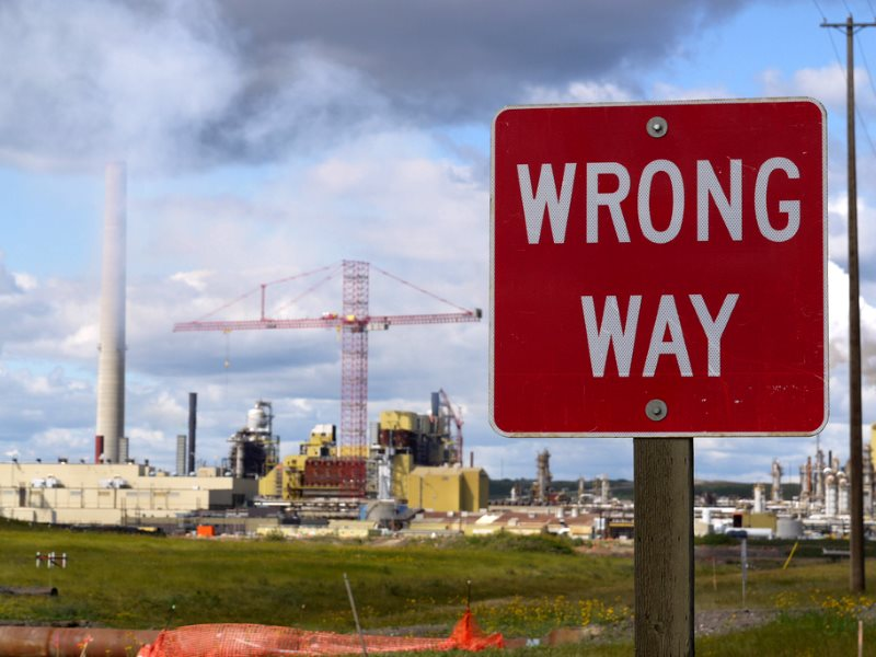 'Wrong way!' Roadside view of Alberta tarsands processing plant. Photo: Velcrow Ripper via Flickr (CC BY-NC).