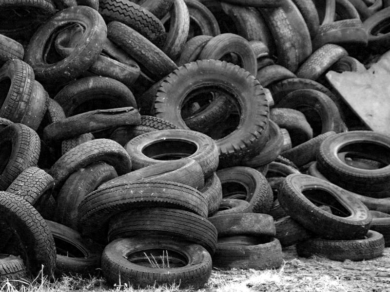 A pile of used car tyres