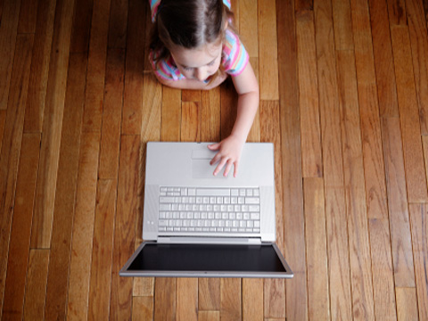A young girl on a wireless laptop