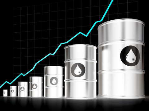 a rising price line behind oil barrels
