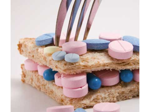 Pill sandwich with a fork sticking out