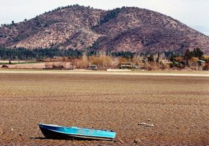 Boat on dried out lakebed