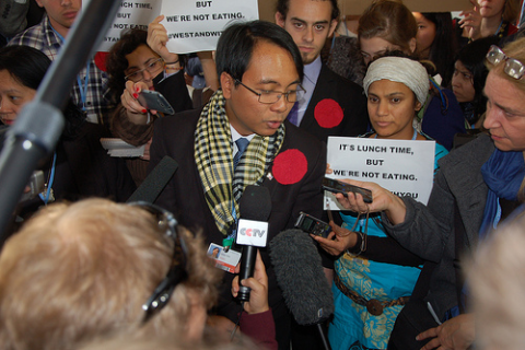 Yeb Sano surrounded by supporters at COP19.