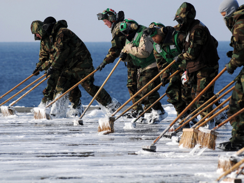 Sailors decontaminate the flight deck aboard USS Ronald Reagan, March 23 2011. Official U.S. Navy Page / Kevin B. Gray via Flickr.com.
