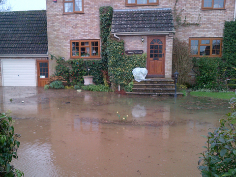 A flooded home, recently built, at Severn Stoke, Worcester. Photo: Dave Throup.