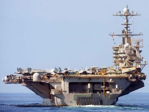The US military is the world's single largest consumer of fossil fuels. Pictured here is US Navy Aircraft Carrier USS John C Stennis. Photo: Defence Images via Flickr.com.