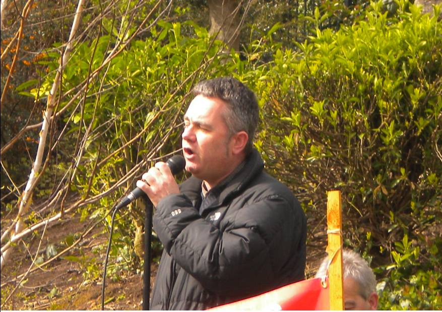 Dominic Dyer addressing a public meeting against the badger cull in Exeter. Photo: Lesley Docksey.