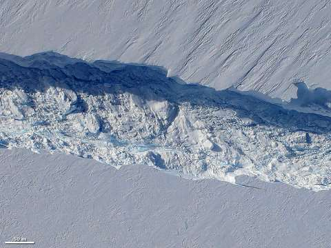 Birth of an iceberg: a massive crack in West Antarctica's Pine Island glacier. Photo: NASA Earth Observatory / Wikimedia Commons.