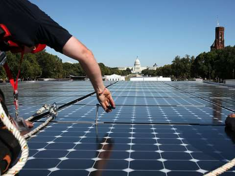 Bypassing Washington DC, the fossil fuel lobby works discreetly at state level. Photo: Solar Decathlon on the National Mall in Washington, 2009. By Stefano Paltera / US Dept. of Energy Solar Decathlon via Flickr.