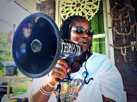 Shu takes to the megaphone to get her message across - water is a human right! Photo: Detroit Water Brigade via facebook.com/waterbrigade .