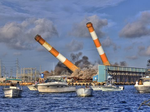 The end of fossil fuel emissions is not the end of global warming! Florida Power & Light's smokestacks come down at Riviera Beach. Photo: Kim Seng via Flickr.