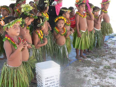 A welcoming committee at Christmas Island - site of the UK's Grapple X and Grapple Y bomb tests. But do these children, or their parents, know about the long term legacy of uranium pollution? Photo: Philip via Flickr.