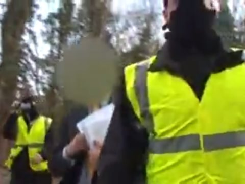 The moment when journalist and photographer Adrian Arbib was served with an injunction preventing him from photographing an environmental protest at Radley lakes, 2007. Photo: still from video by Adrian Arbib.