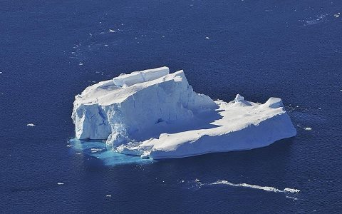 An iceberg floating in the Amundsen Sea, where glaciers are shedding ice faster than in any other part of Antarctica. Photo: NASA / Jane Peterson via Wikimedia Commons.