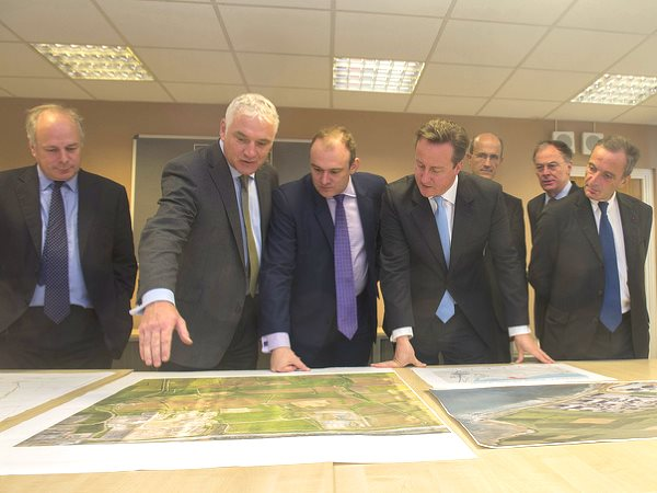 David Cameron, the Prime Minister, and Edward Davey, Secretary of State for Energy, join EDF's top brass to view plans for the Hinkley C nuclear power plant. Photo: Number 10 via Department of Energy and Climate Change / Flickr (CC BY-ND 2.0).