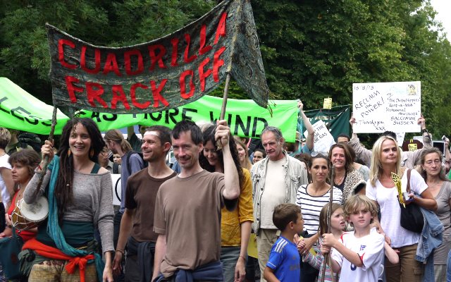 It's had an impact - on fracking companies' valuations: aAnti-fracking campaigners at Cuadrilla drilling site at Balcombe, West Sussex, August 2013. Photo: Sheila via Flickr (CC-BY-NC 2.0).