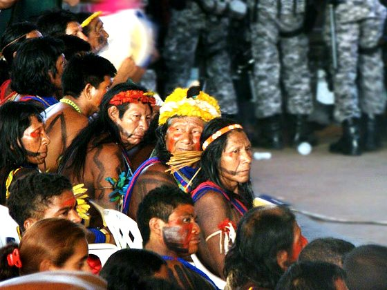 Indian tribes from the Xingu region protest at a Public Hearing for the Belo Monte dam in September 2009. Behind them stands a detachment from Brazil's National Security Force. Photo: J.Gil via Flickr (CC BY-NC-SA 2.0).