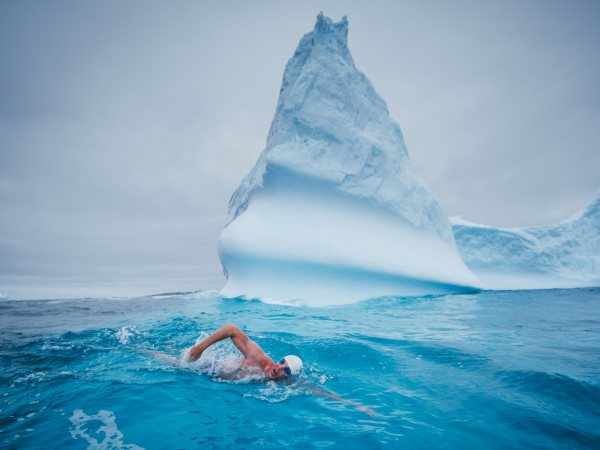 Lewis Pugh swimming 500m in water with a temperature of 0°C off the coast of Peter I Island in the Bellinghausen Sea - one of 13 seas which surround Antarctica. Photo: lewispugh.com.