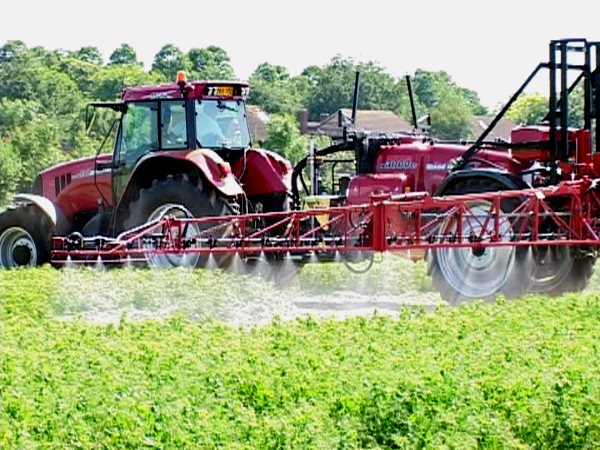 A tractor spraying unknown chemicals in the British countryside. Photo: Billy Ridgers, author provided.
