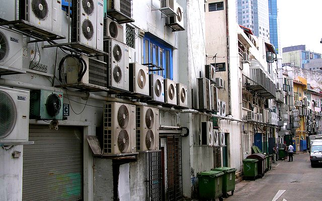 HFCs are widely used in air-con systems like these in a Singapore back alley. Photo: Magalie L'Abbé via Flickr (CC BY-NC).