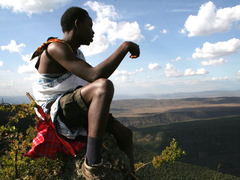 Reuben Sempui seated on a rock on the peak of the volcano Suswa. Photo: Simone Sarchi.