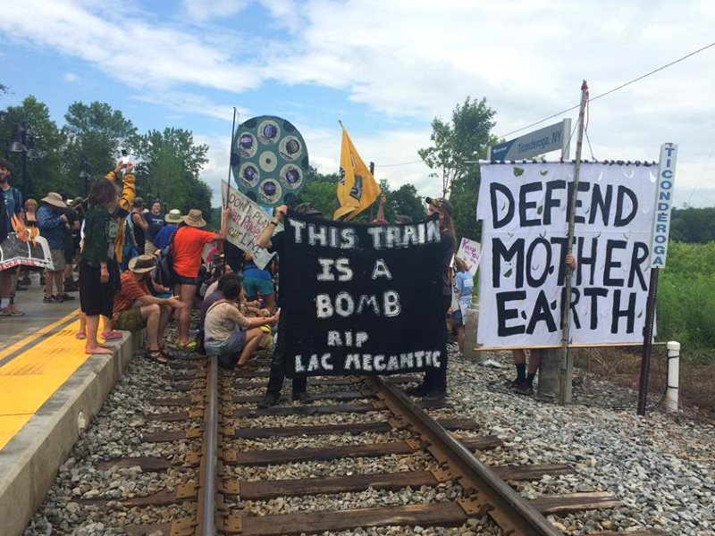 More than a hundred people converged in Ticonderoga, NY on 7th July for a flotilla and symbolic blockade to ‪#StopOilTrains. Photo:  Rising Tide Vermont.