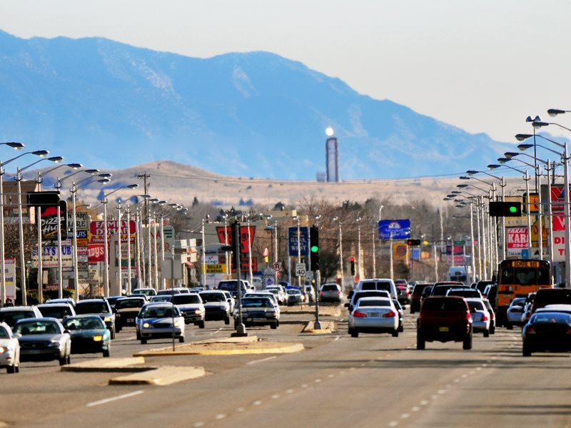 Behind Juan Tabo Boulevard, Albuquerque, the promise of a solar future: Sandia's solar tower, its mirrors reflecting the New Mexico sunlight. Photo: Randy Montoya / Sandia Labs via Flickr (CC BY-NC-ND).