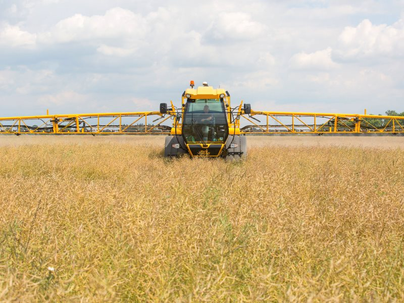 Chafer Multidrive FC applying glyphosate and podstick to oilseed rape crop as pre-harvest dessicant. Photo: Chafer Machinery via Flickr (CC BY).