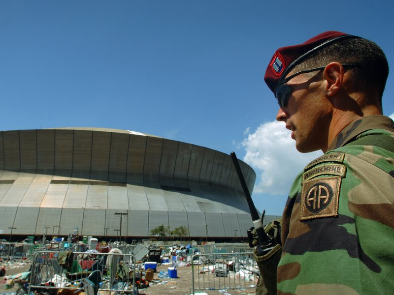 On patrol outside the Superdome in New Orleans, Louisiana (LA), during Hurricane Katrina relief Operations. Photo: Expert Infantry via Flickr (CC BY).
