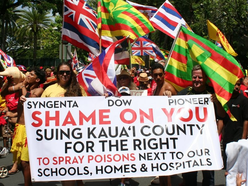 After four separate attempts to rein in the biotech companies failed, an estimated 10,000 people marched through Honolulu's Waikiki tourist district. Photo: Christopher Pala.